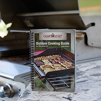 CAMP CHEF<sup>&reg;</sup> Outdoor Cookbook - This outdoor cooking guide is filled with over 100 recipes and tips to have you cooking like a pro.  Whether you love patio cooking, tailgating, barbecuing or camping, there are dozens of easy-to-follow recipes in this cookbook.