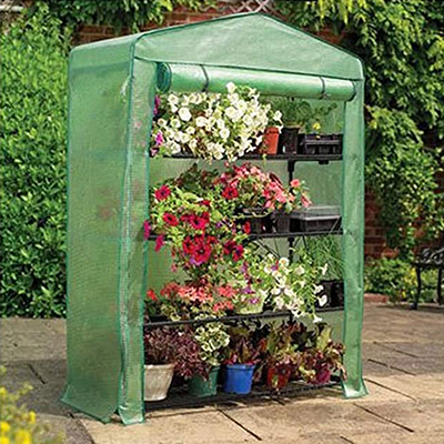 GARDMAN<sup>&reg;</sup> 4 Tier Greenhouse - This easy to use, extra wide mini greenhouse will help you get an early start on your gardening next season.  Features strong push fit tubular steel frame, heavy duty reinforced polyethylene cover, and roll-up zippered door for easy access.  Measures 18&quot;L x 47&quot;W x 63&quot;H.