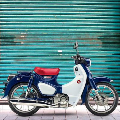 HONDA<sup>&reg;</sup> Super Cub C125 ABS - Great for day-to-day transportation or just riding enjoyment, the Super Cub C125 ABS celebrates the legendary Super Cub heritage. Features a air-cooled single-cylinder four-stroke engine, helical primary gear and high-quality crank-journal bearing for noise reduction, steel frame, high-density urethane seat and more. LED lighting adds a modern touch. One-channel ABS standard.