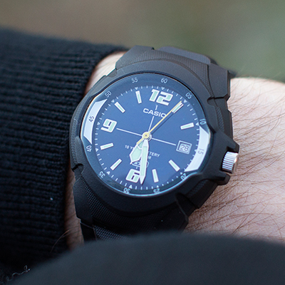 CASIO<sup>&reg;</sup> Men's 100M HD Series Sports Watch - This all black, men's sports watch is water resistant to 100 meters.  Includes a 3-hand analog with date display, luminous dial and buckle clasp.